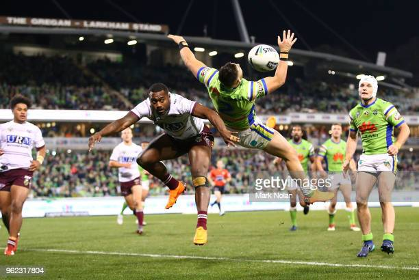 Akuila Uate of the Eagles and Nikola Cotric of the Raiders contest a high ball during the round 12 NRL match between the Canberra Raiders and the...
