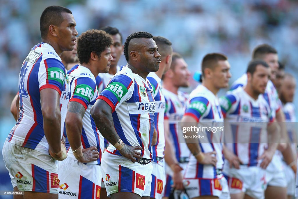 Akuila Uate of the Knights and his team mates look dejected after a Rabbitohs try during the round two NRL match between the South Sydney Rabbitohs and the Newcastle Knights at ANZ Stadium on March 12, 2016 in Sydney, Australia.
