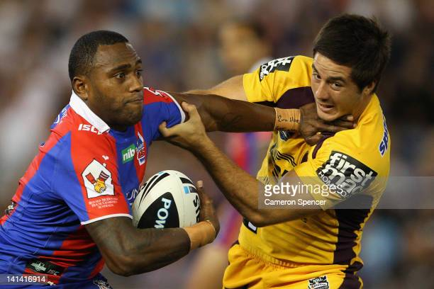 Akuila Uate of the Knights is tackled by Ben Hunt of the Broncos during the round three NRL match between the Newcastle Knights and the Brisbane...