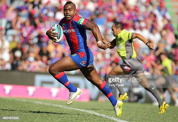 Akuila Uate of the Knights runs the ball downfield during the round one NRL match between the Newcastle Knights and the New Zealand Warriors at...