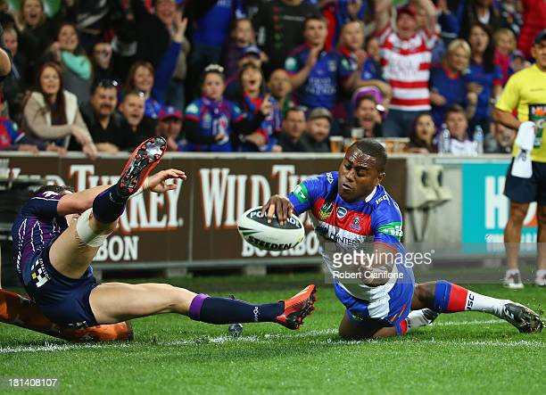 Akuila Uate of the Knights scores a try during the NRL Second Semi Final match between the Melbourne Storm and the Newcastle Knights at AAMI Park on...