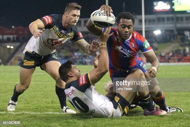 Akuila Uate of the Knights scores a try during the round 15 NRL match between the Newcastle Knights and the North Queensland Cowboys at Hunter...
