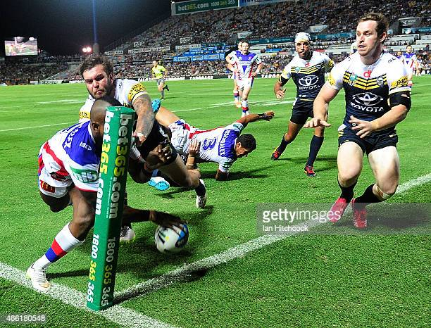 Akuila Uate of the Knights steps on the line as he attempts to score a try during the round two NRL match between the North Queensland Cowboys and...