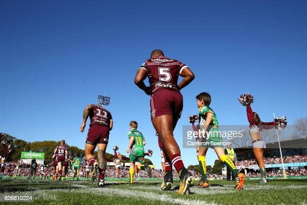 Akuila Uate of the Sea Eagles and team mates run onto the field during the round 22 NRL match between the Manly Warringah Sea Eagles and the Sydney...