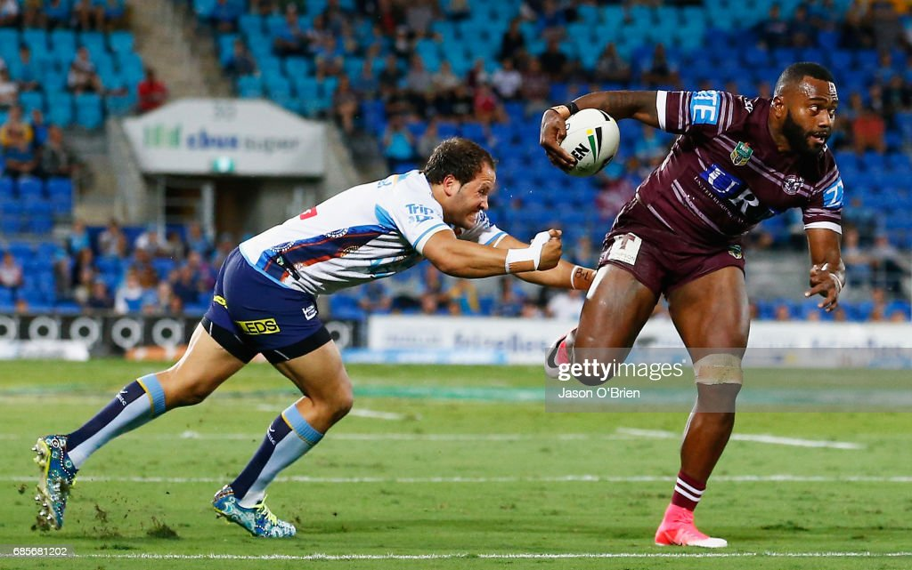 Akuila Uate of the Sea Eagles breaks the tackle of Tyrone Roberts of the Titans during the round 11 NRL match between the Gold Coast Titans and the Manly Sea Eagles at Cbus Super Stadium on May 20, 2017 in Gold Coast, Australia.