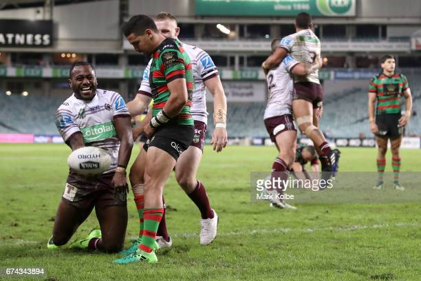 Akuila Uate of the Sea Eagles celebrates scoring a try as Cody Walker of the Rabbitohs looks dejected during the round nine NRL match between the...