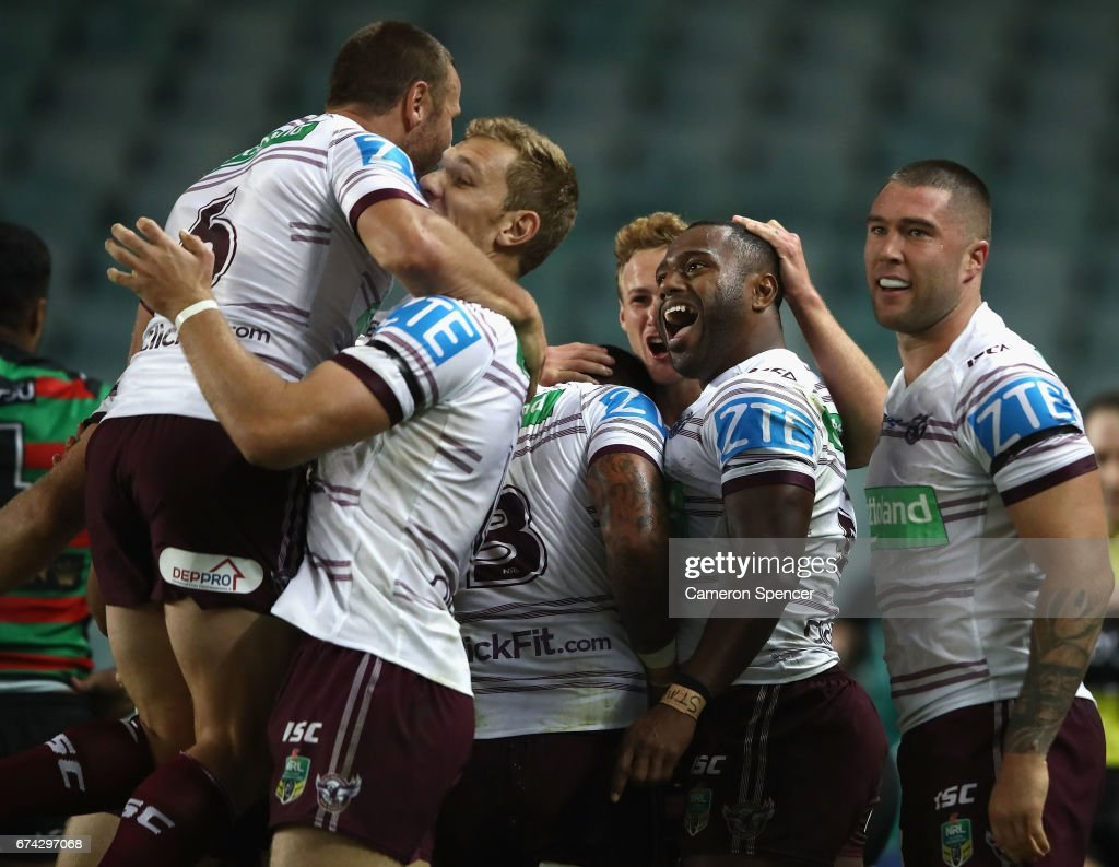 Akuila Uate of the Sea Eagles is congratulated by team mates after scoring a try during the round nine NRL match between the South Sydney Rabbitohs and the Manly Sea Eagles at Allianz Stadium on April 28, 2017 in Sydney, Australia.