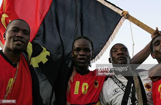 Akwa of Angola celebrates with Miloy after securing a valuable draw after the 2006 World Cup Qualifying match between Nigeria and Angola at the Sany...