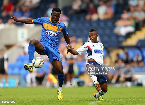 Akwasi Asante of Shrewsbury Town and Robert Hall of Bolton Wanderers