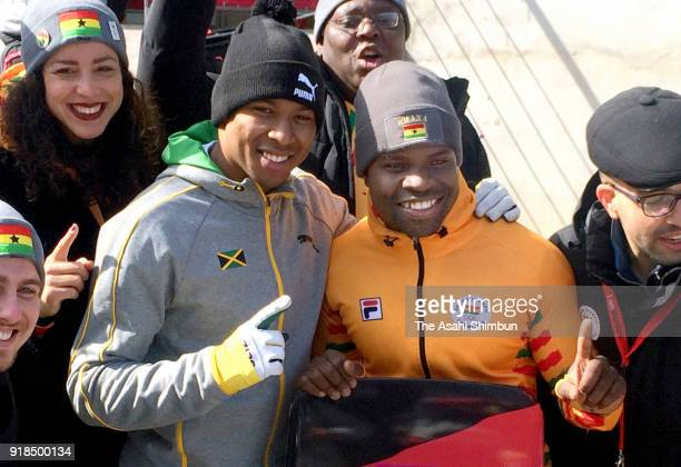 Akwasi Frimpong of Ghana poses for photographs with Anthony Watson of Jamaica after the Men's Skeleton heats on day six of the PyeongChang 2018...