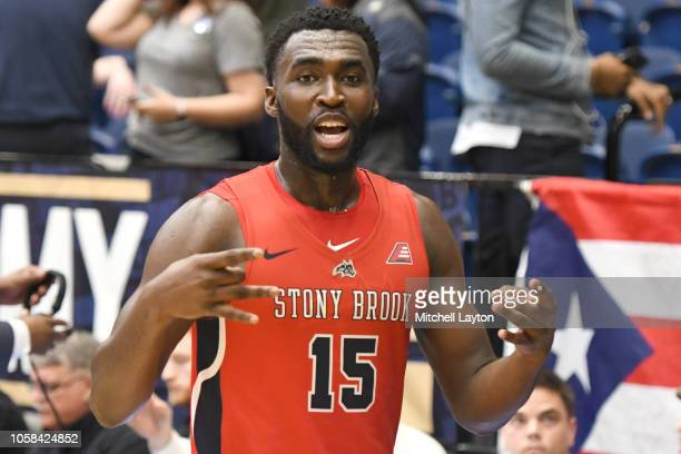 Akwasi Yeboah of the Stony Brook Seawolves celebrates a overtime win after a college basketball game against the George Washington Colonials at the...
