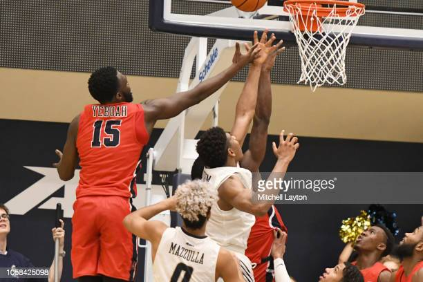 Akwasi Yeboah of the Stony Brook Seawolves drives to the basket to put the game in overtime during a college basketball game against the George...