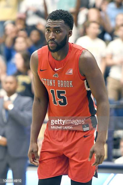 Akwasi Yeboah of the Stony Brook Seawolves looks on during a college basketball game against the George Washington Colonials at the Smith Center on...