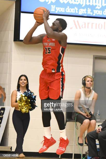 Akwasi Yeboah of the Stony Brook Seawolves takes a jump shot during a college basketball game against the George Washington Colonials at the Smith...