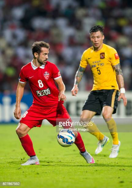 Al Ahli midfielder Everton Augusto De Barros Ribeiro fights for the ball with Guangzhou Evergrande defender Zhang Linpeng during the AFC Champions...