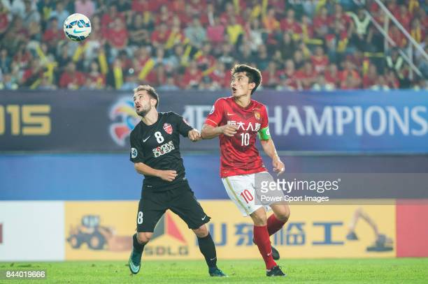 Al Ahli midfielder Everton Augusto De Barros Ribeiro fights for the ball with Guangzhou Evergrande midfielder Zheng Zhi during the AFC Champions...