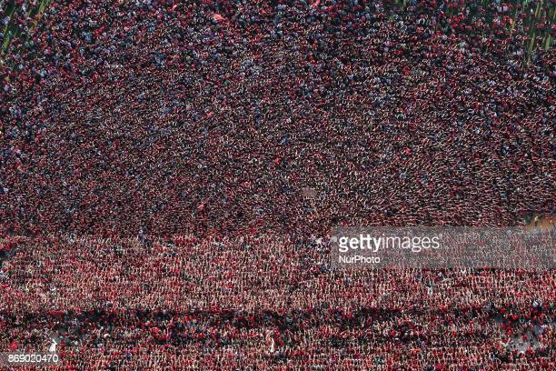 Al Ahli's fans cheer for their team during the last exercise before traveling to Morocco, Al-Ahli officials have agreed to open the stadium in front...