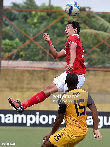 Al Ahly of Egypt's Amr Gamal Sayed vies with ASEC Mimosas of Ivory Coast's Nabi Ibrahim Kone during the CAF Champions League football match between...