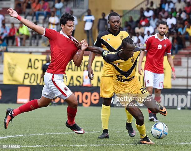 Al Ahly of Egypt's Amr Gamal Sayed vies with ASEC Mimosas of Ivory Coast's Daouda Diarrassouba during the CAF Champions League football match between...