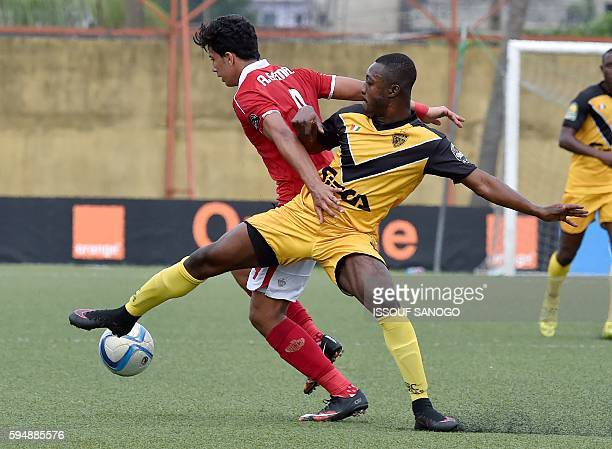 Al Ahly of Egypt's Amr Gamal Seyed vies with ASEC Mimosas of Ivory Coast's Wilfried Aranut Akassou during the CAF Champions League football match...