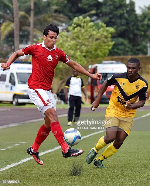Al Ahly of Egypt's Amr Gamal vies with ASEC Mimosas of Ivory Coast's Armand Boti during the CAF Champions League football match between Asec and Al...