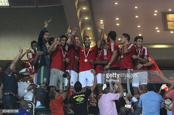 Al Ahly players celebrate after the Egyptian Premier League soccer match at the Cairo Stadium in Cairo Egypt 07 July 2014 AlAhly were crowned...