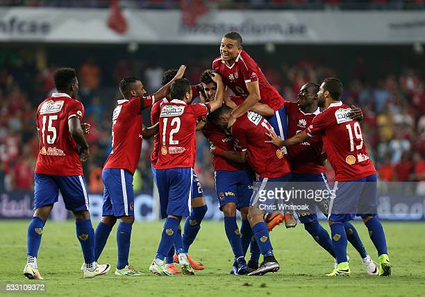 Al Ahly's Ahmed Mohammed celebrates his winning goal during the international friendly match between AS Roma and Al Ahly on May 20 2016 in Al Ain...