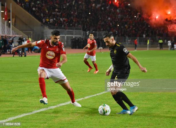 Al Ahly's Ali maaloul and Etoile's Zied boughatas in action during the CAF Champions League 2019 20 football match between AlAhly and Etoile sportive...