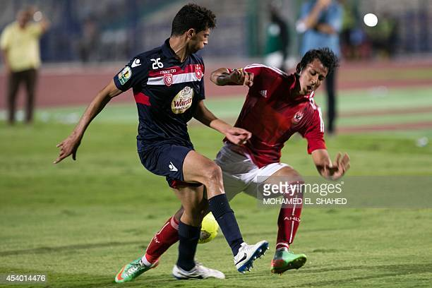 Al Ahly's Egyptian Amr Gamal vies with Etoile du Sahel's Rami Bedoui during their CAF Confederation Cup group B football match Egypt's alAhly versus...