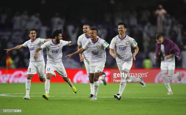 Al Ain players celebrate penalty shoot out victory in the FIFA Club World Cup first round playoff match between Al Ain FC and Team Wellington FC at...