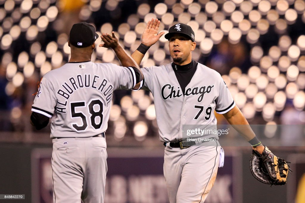 Al Alburquerque #58 and Jose Abreu #79 of the Chicago White Sox celebrate defeating the Kansas City Royals at Kauffman Stadium on September 11, 2017 in Kansas City, Missouri.