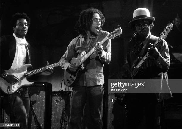 Al Anderson Bob Marley and Aston 'Family Man' Barrett of The Wailers perform on stage at the Odeon Birmingham United Kingdom 18 July 1975