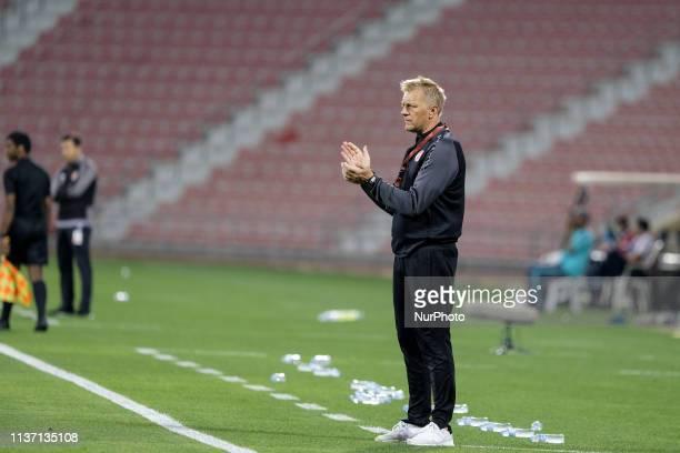 Al Arabi coach Heimir Hallgrímsson encourages his team from the sidelines during Al Arabi 03 Al Duhail at the Grand Hamad Stadium Doha Qatar on 13...