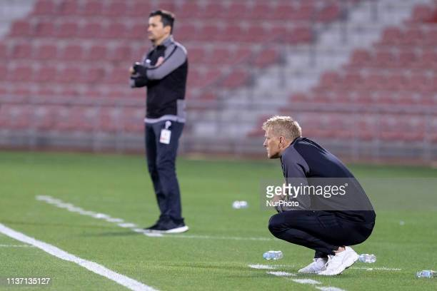 Al Arabi coach Heimir Hallgrímsson watches his team from the sidelines during Al Arabi 03 Al Duhail at the Grand Hamad Stadium Doha Qatar on 13 April...