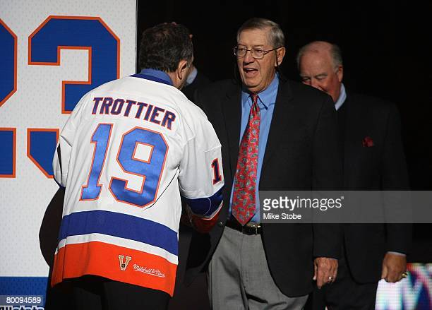 Al Arbour and Bryan Trottier of 'The 'Core of the Four' New York Islanders Stanley Cup championships take part in a ceremony prior to the Islanders...