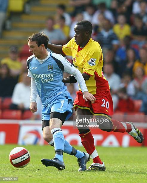 LONDON APRIL 21 Al Bangura of Watford tangles with Stephen Ireland of Manchester City during the Barclays Premiership match between Watford and...