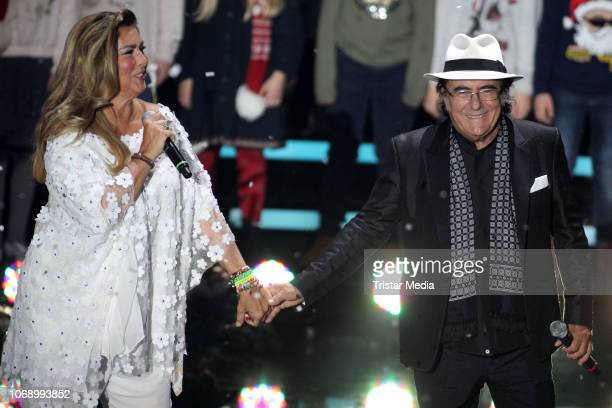 Al Bano and Romina Power perform during the charity tv show 'Die schoensten WeihnachtsHits' in favor of MISEREOR and Brot fuer die Welt on December 5...
