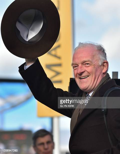 Al Boum Photo's Irish trainer Willie Mullins celebrates after winning the Gold Cup race on the final day of the Cheltenham Festival horse racing...