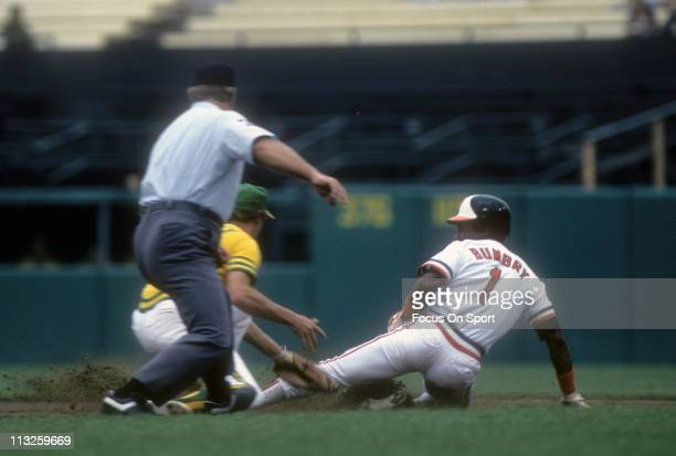 Al Bumbry of the Baltimore Orioles slides into second base against the Oakland Athletics during a Major League Baseball game circa 1975 at Memorial...