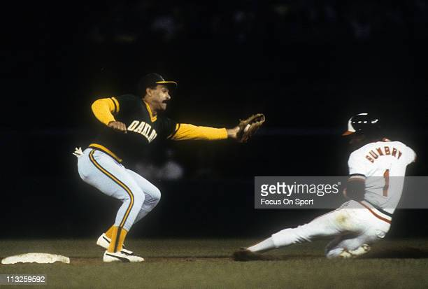 Al Bumbry of the Baltimore Orioles slides into second base under Davey Lopes of the Oakland Athletics during a Major League Baseball game circa 1983...