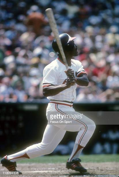 Al Bumbry of the Baltimore Orioles swings and watches the flight of his ball during a Major League Baseball game circa 1975 at Memorial Stadium in...