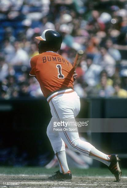 Al Bumbry of the Baltimore Orioles swings and watches the flight of his ball during a Major League Baseball game circa 1982 at Memorial Stadium in...