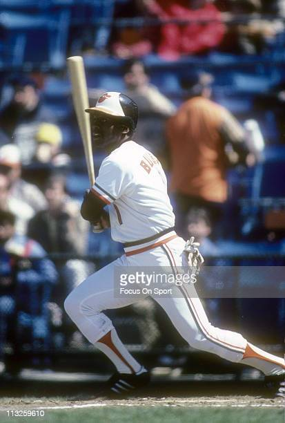 Al Bumbry of the Baltimore Orioles swings and watches the flight of his ball during a Major League Baseball game circa 1983 at Memorial Stadium in...