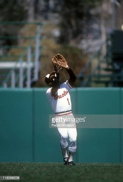 Al Bumbry of the Baltimore Orioles tracks a fly ball during a Major League Baseball game circa 1982 at Memorial Stadium in Baltimore Maryland Bumbry...