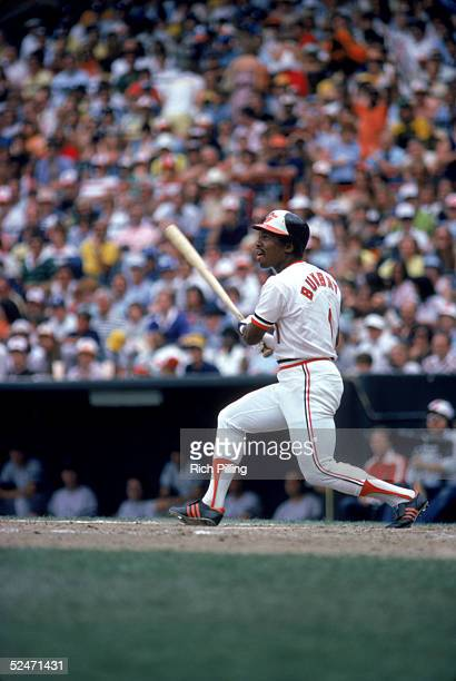 Al Bumbry of the Baltimore Orioles watches the flight of the ball as he follows through on his swing during a game in August of 1980 at Oriole Park...