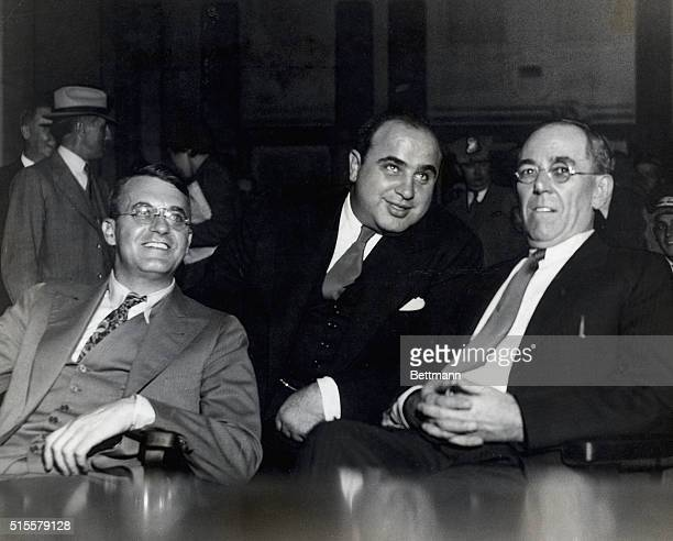 Al Capone . American gangster with lawyers at hearings of Federal Grand Jury, where he was indicted for income tax evasion. Photograph.