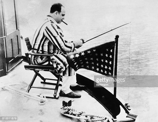 Al Capone fishing from a boat.