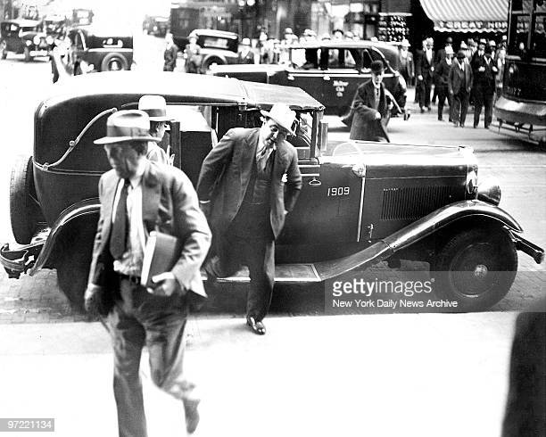 Al Capone leaving a taxi outside the Chicago Federal Courthouse to attend his trial