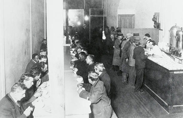 People Eating at a Soup Kitchen Pictures | Getty Images