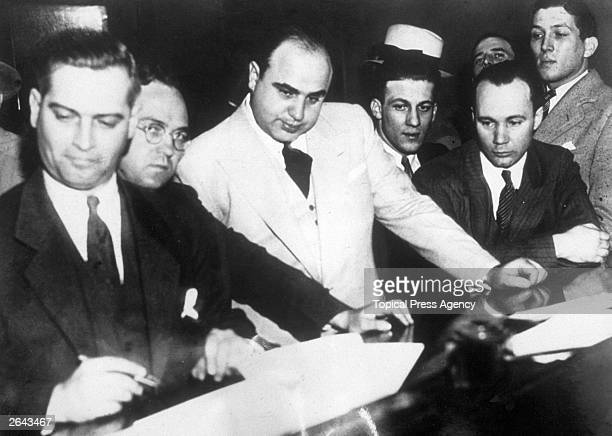 Al Capone signing Uncle Sam's $50,000 bail bond in the Federal Building, Chicago.